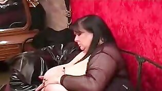 Chubby gothic girl plays with boobies