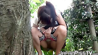 teasing play: Cute Asian chick Ai Nishimura is pissing on cocks